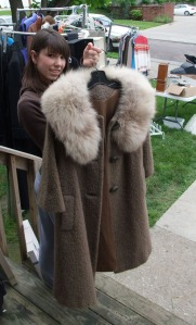 Emily Spain shows off a vintage coat for sale.