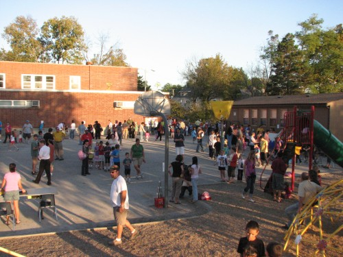 Aerial view of families at Lee's fall carnival